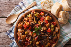 Italian Caponata with aubergines closeup in a plate. horizontal Royalty Free Stock Photography