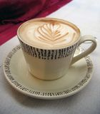 Italian cappuccino. A cup of Italian cappuccino the way is served in Milan Stock Images