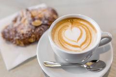Italian cappuccino with fresh almond cornetti Stock Photography