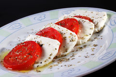 The italian Caprese - food. The typical italian food so called caprese, with mozzarella and tomatoes Stock Photo