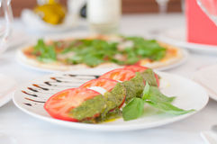 Italian caprese with pesto and basil Royalty Free Stock Image