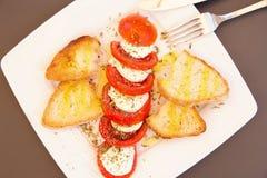 Italian caprese salad with  fresh mozzarella, tomatoes, olive oi Royalty Free Stock Photography