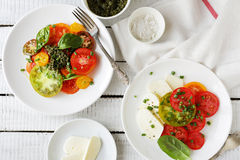 Italian caprese salad and tomato on plate Stock Photo