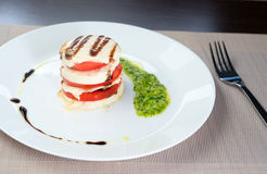 Italian Caprese. Tomato and mozzarella lies on a plate Royalty Free Stock Photography