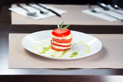 Italian Caprese. Tomato and mozzarella lies on a plate Stock Photo