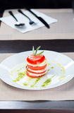Italian Caprese. Tomato and mozzarella lies on a plate Stock Images