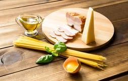 Italian carbonara ingredients on wooden background Stock Image