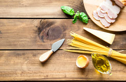 Italian carbonara ingredients on wooden background Royalty Free Stock Images