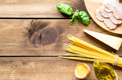 Italian carbonara ingredients on wooden background Royalty Free Stock Photo