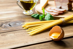Italian carbonara ingredients on wooden background Royalty Free Stock Photography
