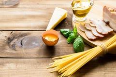 Italian carbonara ingredients on wooden background Stock Images