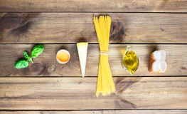 Italian carbonara ingredients on wooden background Stock Photos