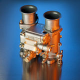 Italian carburetor. Carburetor in orange and blue used in high performance sports cars Royalty Free Stock Photography