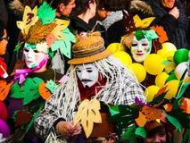 Italian Carnevale. Carnival masks in parade on Mardi Gras