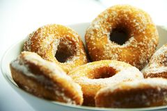 Italian carnival donuts sweet with sugar on top. Italian carnival tipical sweets zeppole from Marche region on a white plate, a lot of sweet sugar Royalty Free Stock Photo