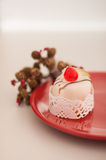 Italian cassata on a red plate Stock Photography