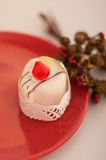 Italian cassata on the red plate Royalty Free Stock Image