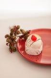 Italian cassata on red plate Royalty Free Stock Photography