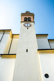 Italian catholic church exterior of the parish Santa Maria in Valli del Pasubio, Italy. On a sunny day, blue sky background stock photo