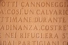 Italian characters on a stone tablet Royalty Free Stock Images