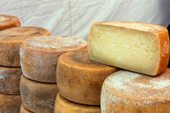 Italian cheese. Heap of italian seasoned cheese - market of artisan products from south italy Stock Image
