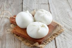 Italian cheese burrata. On a wooden table close up stock photos