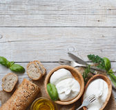 Italian cheese burrata, olive oil and bread Royalty Free Stock Images