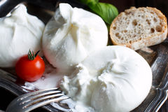 Italian cheese burrata, tomatoe and basil Stock Photo