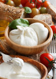 Italian cheese burrata, tomatoes, basil and bread Royalty Free Stock Images