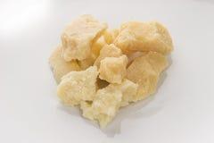 Italian cheese - Grana padano. On white background Stock Images