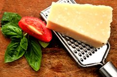 Italian cheese for making pesto sauce and basil Stock Images