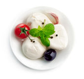 Italian cheese mozzarella plate with leaf basil Stock Photos