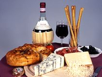 Italian cheese, wine and bread. Royalty Free Stock Photo