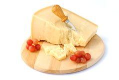 Italian cheese on wooden cutting board with red gr Stock Photos