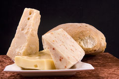 Italian Cheeses. Bread with an assortment of Italian cheeses stock photos