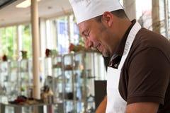 Italian chef. Cooking Stock Image