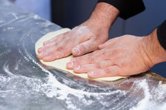 Italian chef preparing pizza dough Stock Images