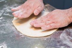 Italian chef preparing pizza dough Stock Image