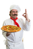 Italian Chef. Smiling Italian chef with a pizza in hand Royalty Free Stock Image