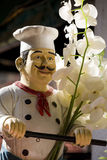 Italian chef statue. With flowers Royalty Free Stock Photography