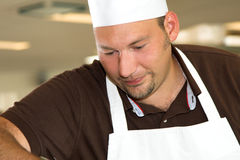 Italian chef working concentrated royalty free stock photo
