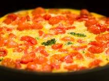 Italian cherry tomato broccoli frittata Royalty Free Stock Photo