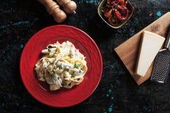 Italian chicken alfredo fettuccine pasta Stock Photo