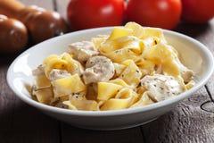 Italian chicken alfredo pasta Stock Photos
