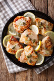 Italian chicken piccata with sauce, lemon and capers close-up on Royalty Free Stock Photography