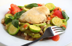 Italian chicken, with zucchini, beans and tomato Royalty Free Stock Images