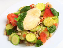 Italian chicken with zucchini, beans and tomato Stock Photos