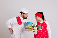 Italian Chief cook and Handsome Cooky with Tray of Vegetables Stock Photo