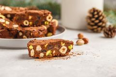 Italian Christmas dessert panforte with nuts, chocolate and candied fruits. Christmas background