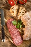 Italian ciabatta bread cut in slices with salami. Stock Photography